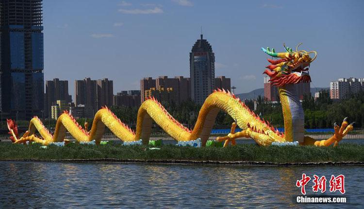 """126米""""中华第一巨龙""""亮相山西汾河"""