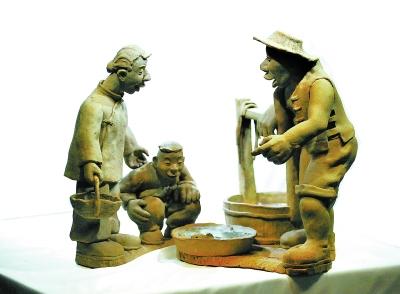 <strong>陶艺雕塑:泥火交织还原运河之魂</strong>