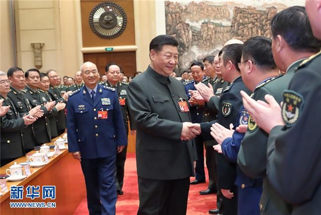 习近平出席解放军和武警部队代表团全