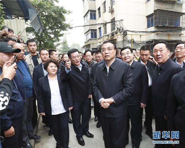李克强:促进经济平稳发展和民生持续改善